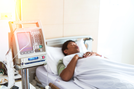 Close up of a patient in hospital with saline intravenous (iv), select focus Stock Photo - 91974451