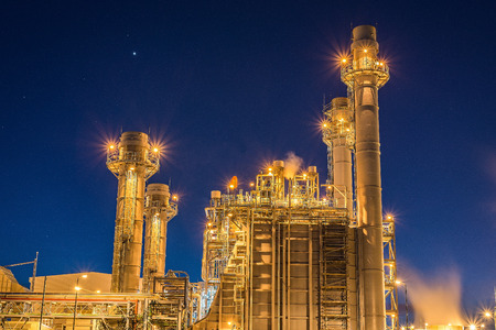 Big Industrial oil tanks in a refinery with treatment pond at industrial plants Stock Photo