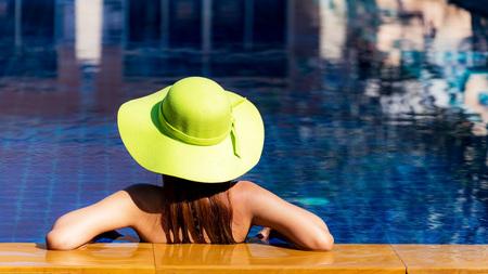 Woman in swimsuit relaxing  on, greenery tone Stok Fotoğraf