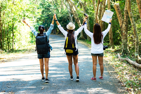 Group of beautiful young women walking in the forest, enjoying vacation, travel concept, soft and select focus