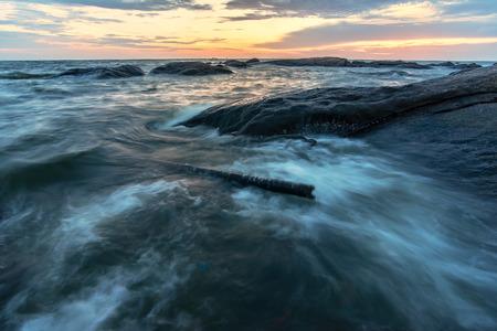 Long exposure seascape rocks at twilight