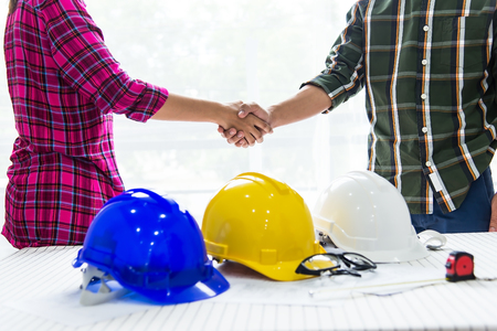 Team of professional engineers are shaking hands while working in the office center. Construction concept,worke,industry,occupational Stock Photo