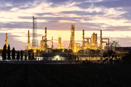 Gas turbine electrical power plant at dusk with orange sky
