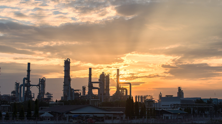 Gas turbine electrical power plant at dusk with orange sky,industrial
