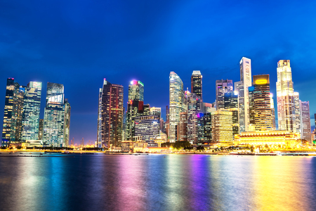 Singapore Skyline. Singapore`s business district, blue sky and night view for marina bay Editorial