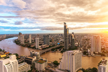 Aerial view over Bangkok modern office building in bangkok business zone near the river with sunset sky in Bangkok, Thailand