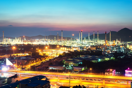 Beautiful scenery during time the twilight view from top of oil refinery industry. Oil refinery industry at Chonburi province in Thailand. Landscape of industry estate in Thailand. Industry concept Stock Photo