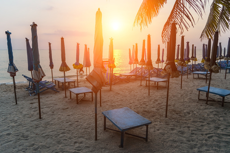 Beautiful beach. Chairs on the sandy beach near the sea. Summer holiday and vacation concept. Inspirational tropical beach. Tranquil scenery, relaxing beach, tropical landscape design.