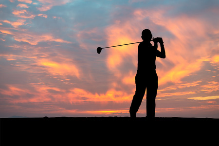silhouette golfer playing golf during beautiful sunset,GOLF BALL ON T-OFF