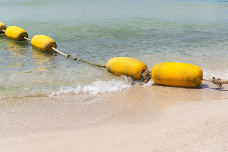 Yellow buoy on the beach