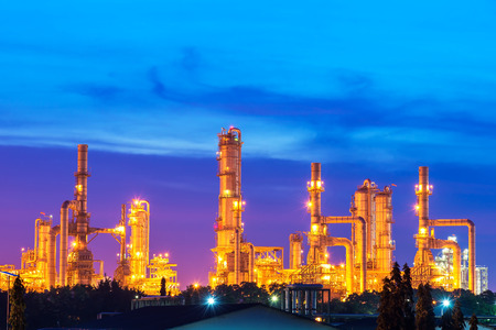 Oil and gas refinery at twilight with reflection - factory - petrochemical plant Stock Photo