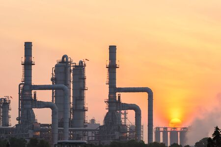 Oil refinery industry at sunrise, Oil refiner Industry background concept Stock Photo