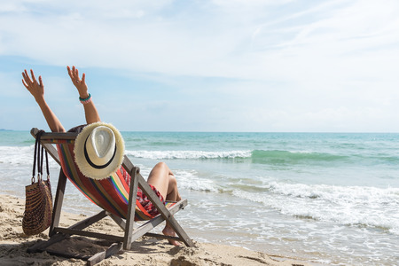 Happy woman with open arms enjoying the summer sea vacation .Summer holiday concept Banque d'images