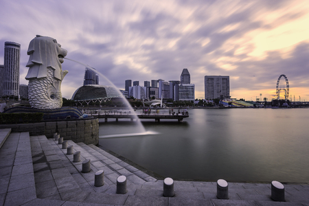 SINGAPORE - January 11 2018: The Merlion fountain and marina bay sands is famous landmark at sunrise of Singapore city