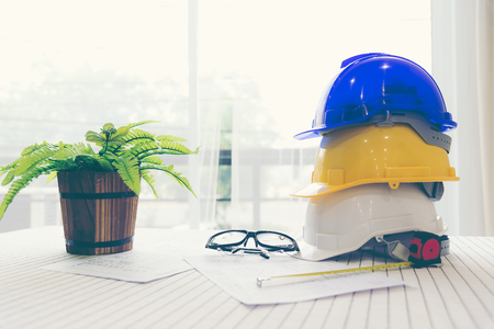 Safety helmet white,blue and yellow for foremanengineerarchitectvisitor use in construction site for safety work,worker,industry Stock Photo