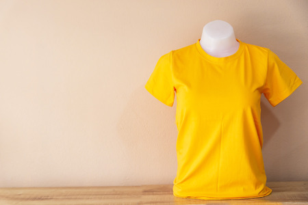 Yellow T-Shirt isolated on a Pastel color background