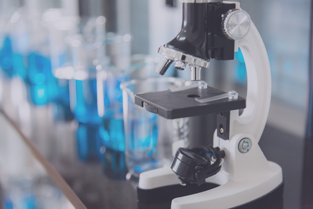 Microscope and test tubes in laboratory  and laboratory tools in reseach laboratory Banco de Imagens