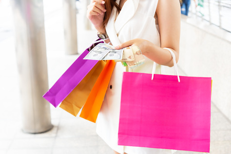 Business Woman holding Credit Card for Online Payment,Euphoric shopper buying on line with a laptop and a credit card at home or office