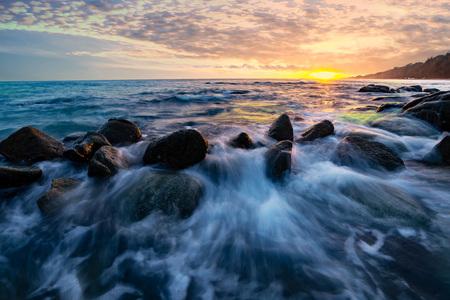 Sea wave hit the rock Beach sunset, Beautiful natural summer seascape ,Phuket, Thailand .