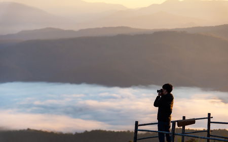 Photographer Landscape Nature Outdoor Hat. during mist sunrise , relax and freedom day. Lifestyle Concept.