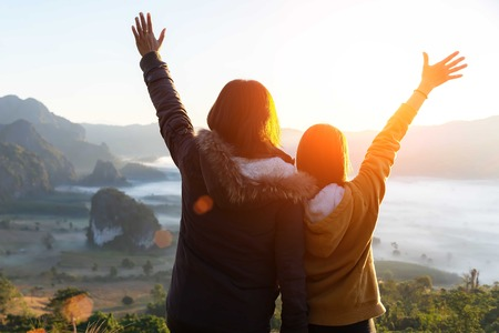 Lifestyle traveler women happy feeling good relax and freedom facing in the sunrise morning. Travel Concept