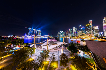 SINGAPORE - January 11 2018: Cityscape of Singapore city skyline at night in Marina Bay with laser show