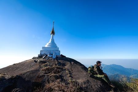Hiker man Mountain Adventure enjoying top View . Travel Concept
