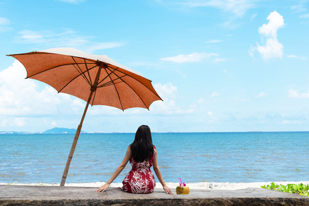 Happy woman enjoying at the beach. Summer vacations concept. Lifestyle and Travel Concept Banco de Imagens