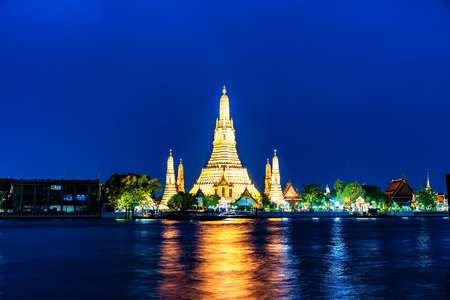 Sunset old temple riverside chao phraya river wat arun temple in bangkok Thailand