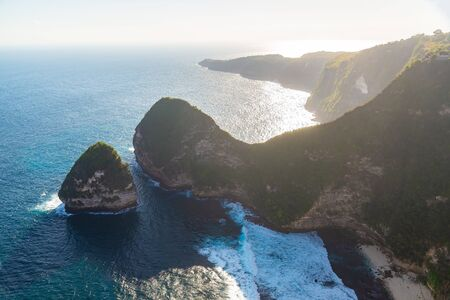 Scenic view on Manta Bay or Kelingking Beach on Nusa Penida Island, Beautiful Bali, Indonesia. Summer holiday concept, travelling in Asia.