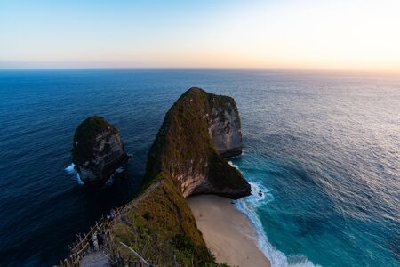 Beautiful Klingking Beach and rocks on the island of Nusa Penida near the island of Bali in Indonesia.Summer holiday concept, travelling in Asia. Фото со стока