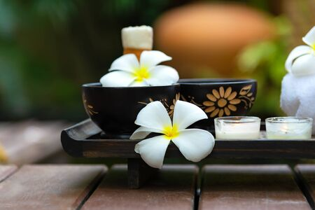 Spa Thai setting for aroma therapy and sugar and salt massage with flower on the bed, relax and healthy care, select focus. Healthy Concept Stock Photo