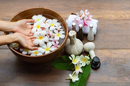 Spa treatment and product for  and manicure nails spa with pink flower and rock stone, copy space, select focus, Thailand. Healthy Concept