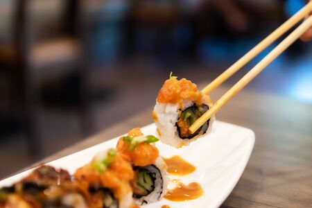 Sushi rolls japanese delicacy. Japanese traditional food from rice and fish. Beautiful serving of food . A set of delicious delicacies.