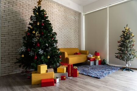 The  living room in the loft is decorated with a Christmas tree. Square. Concept of Happy Christmas, New Year, holiday, background.