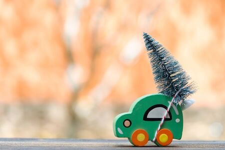 Christmas tree on wood toy car . Christmas holiday celebration concept Фото со стока