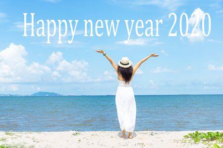 Happy new year card 2020. Silhouette lifestyle woman standing as part of Number 2020 near the beach at sunset