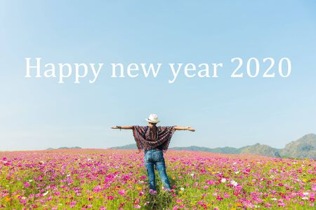 Woman Enjoying on the hill and 2020 years while celebrating new year. Summer and Holiday Concept