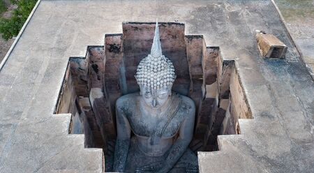 Aerial view shot from drone . Huge Sukhothai stucco Buddha image of Wat Si Chum, Sukhothai, Thailand