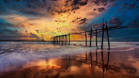 Landscape sunset with old wooden bridge at Khao Pilai beach in Phang Nga province Thailand