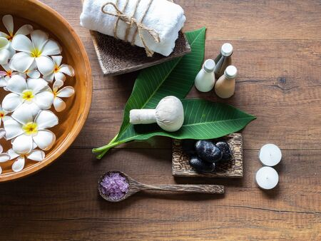 Spa feet and hand thai massage compress balls, herbal ball on the wooden with treatments spa , summer day,Thailand. Healthy Concept.