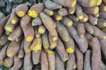 starchy food: Cooked yams  at a market  Stock Photo