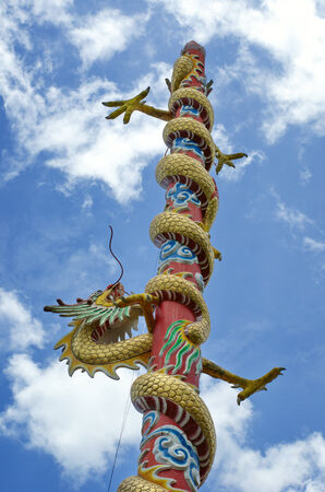 dragon status and blue sky photo