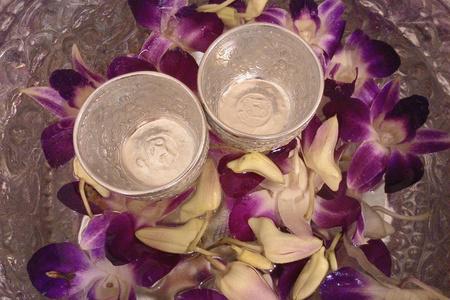sliver: purple orchid flower on sliver bowl Stock Photo