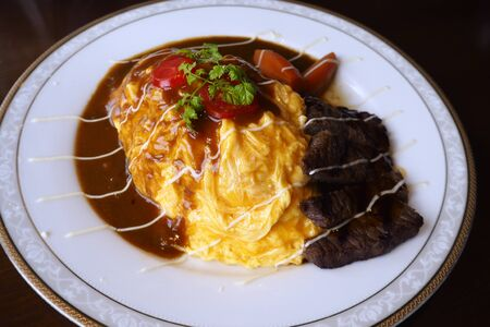 thicken: Rice with eggs thicken serve with tenderloin beef stew in restaurant at japan