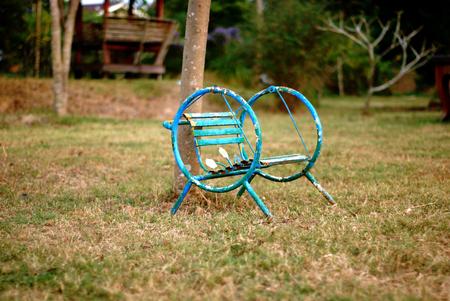 Steel Swing Chair Green Color in the Garden Reklamní fotografie