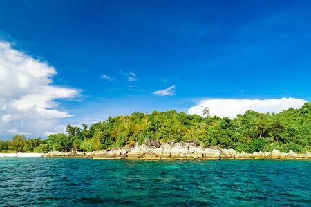 Small island and Tropical sea and blue sky in Andaman sea, Thailand
