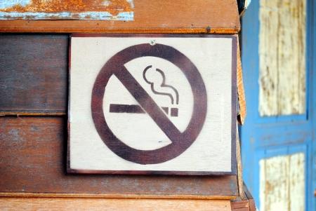 don't: Don t smoking logo on wood