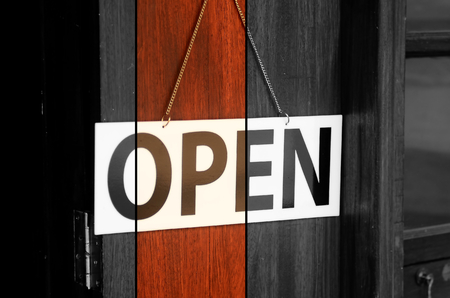 old sign: Open sign broad hanging on wooden door in street cafe.Retro color style. Stock Photo