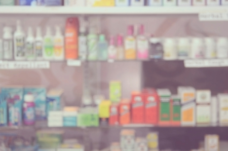 pastel colors: Blurred medicine on shelves.Drugstore background.Retro color style. Stock Photo